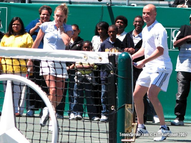 Tennis - Andre Agassi hitting Steffi Graf in mouth with tennis racquet