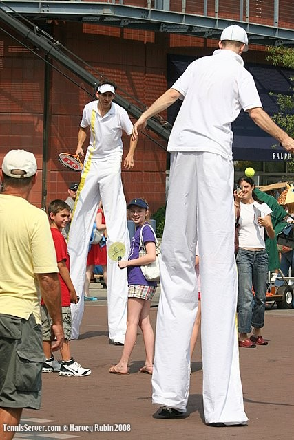 Tennis - Tennis Players on Stilts